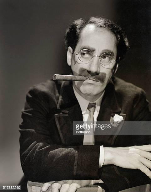 Mustache glasses and cigar never fail to identify Groucho Marx youngest member of the Marx Brothers who completed MGM's The Bargain Basement their...