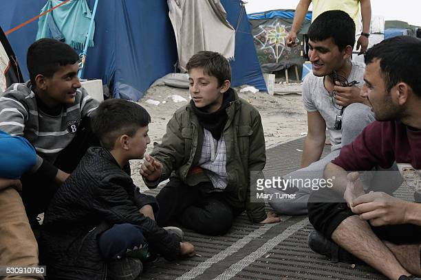 Mustafa a 9year old refugee from Afghanistan plays a game with his friend Wali Khan a characterful 7year old refugee and their friends a group of...