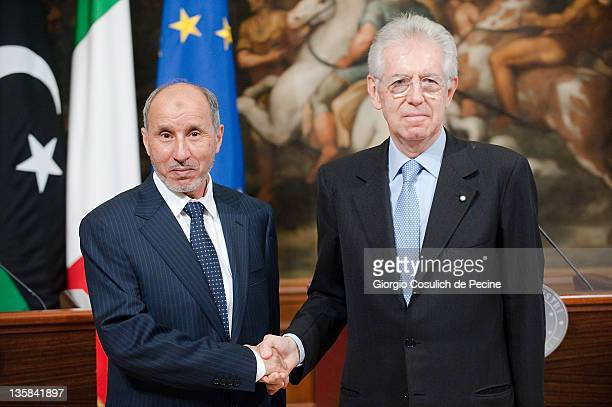 Mustafa Abdel Jalil, the head of Libya's National Transitional Council shakes hands with Italian Prime Minister Mario Monti, at the end of a press...