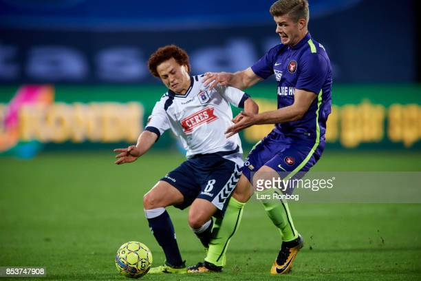 Mustafa Amini of AGF Aarhus and Alexander Sorloth of FC Midtjylland compete for the ball during the Danish Alka Superliga match between AGF Aarhus...