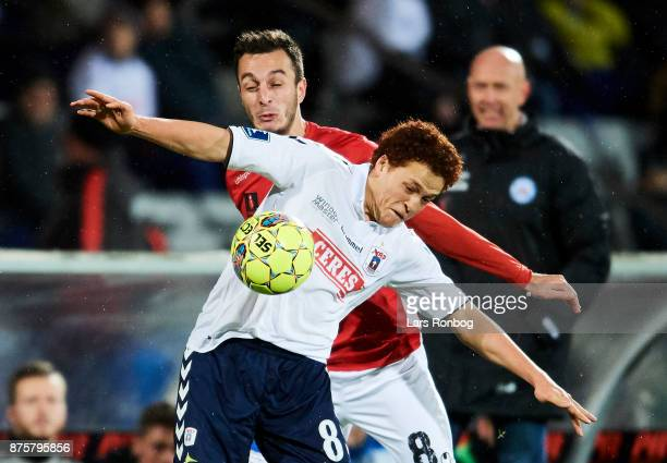 Mustafa Amini of AGF Aarhus and Davit Skhirtladze of Silkeborg IF compete for the ball during the Danish Alka Superliga match between AGF Aarhus and...