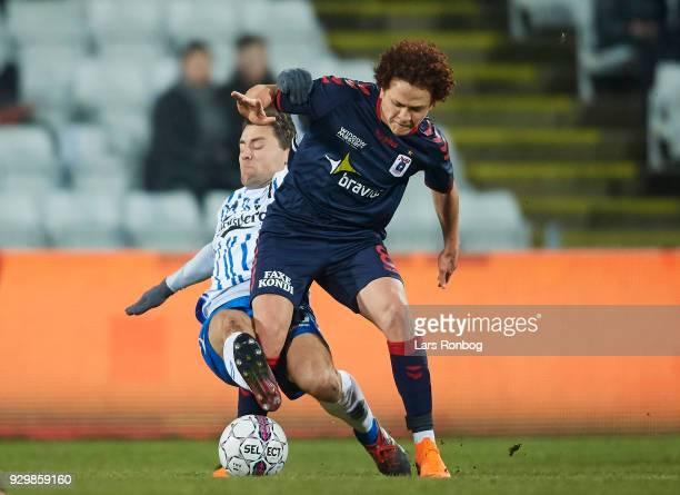 Mustafa Amini of AGF Aarhus and Rasmus Festersen of OB Odense compete for the ball during the Danish Alka Superliga match between OB Odense and AGF...