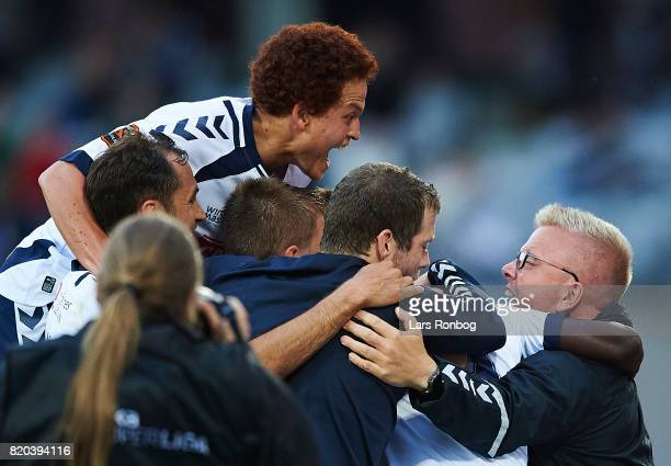 Mustafa Amini of AGF Aarhus and the players of AGF Aarhus celebrates after scoring their second goal during the Danish Alka Superliga match between...