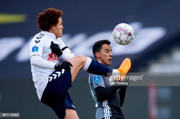 Mustafa Amini of AGF Aarhus and Zeca of FC Copenhagen compete for the ball during the Danish Alka Superliga match between AGF Aarhus and FC...