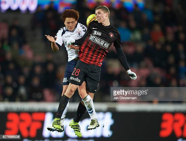 Mustafa Amini of AGF Arhus and Andre Romer of FC Midtjylland compete for the ball during the Danish Alka Superliga match between FC Midtjylland and...