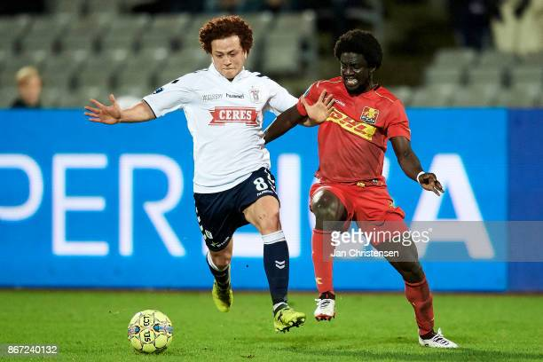 Mustafa Amini of AGF Arhus and Ernest Asante of FC Nordsjalland compete for the ball during the Danish Alka Superliga match between AGF Arhus and FC...
