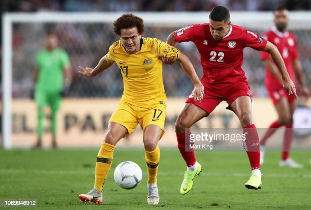 Mustafa Amini of Australia is challenged by Bassel Jradi of Lebanon during the International Friendly Match between the Australian Socceroos and...
