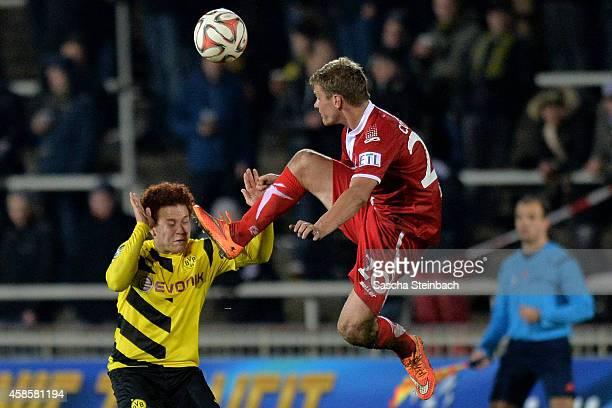 Mustafa Amini of Dortmund and Manuel Zeitz of Cottbus battle for the ball during the 3 Liga match between Borussia Dortmund II and Energie Cottbus at...