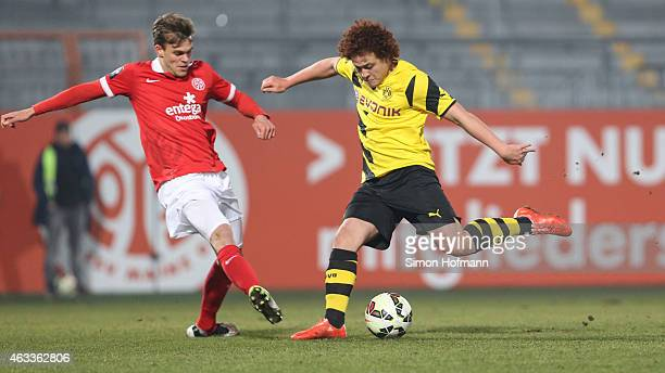 Mustafa Amini of Dortmund is challenged by Benedikt Saller of Mainz during the Third League match between 1 FSV Mainz 05 II and Borussia Dortmund II...