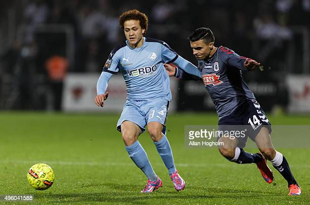 Mustafa Amini of Randers FC and Ahmed Yasin of AGF compete for the ball during the Danish Alka Superliga match between Randers FC and AGF Aarhus at...