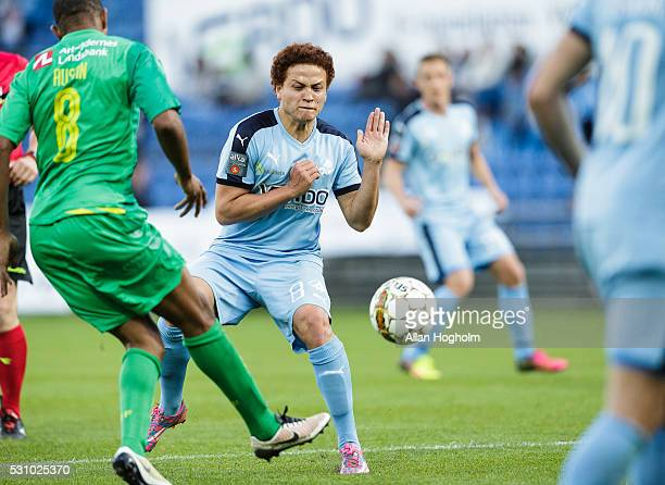 Mustafa Amini of Randers FC and Rodolph Austin of Brondby IF compete for the ball during the Danish Alka Superliga match between Randers FC and...