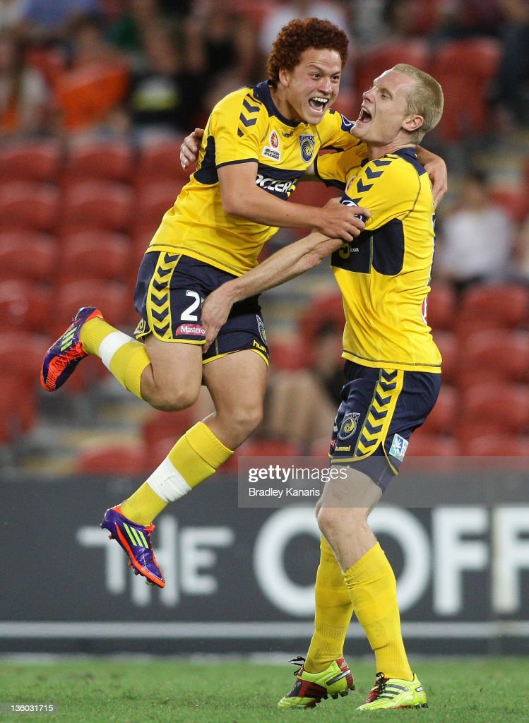 Mustafa Amini (L) of the Mariners celebrates after scoring a goal during the round 11 A-League match between the Brisbane Roar and the Central Coast Mariners at Suncorp Stadium on December 17, 2011 in Brisbane, Australia.