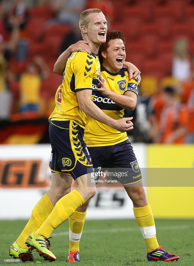 Mustafa Amini of the Mariners celebrates with team mate Matthew Simon after scoring a goal during the round 11 A-League match between the Brisbane Roar and the Central Coast Mariners at Suncorp Stadium on December 17, 2011 in Brisbane, Australia.