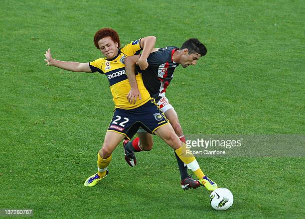 Mustafa Amini of the Mariners challenges Jason Hoffman of the Heart during the round 15 ALeague match between the Melbourne Heart and the Central...
