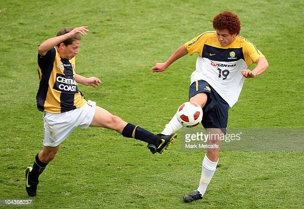 Mustafa Amini of the Young Socceroos and Patricio Perez of the Mariners compete for the ball during the friendly match between the Young Socceroos...