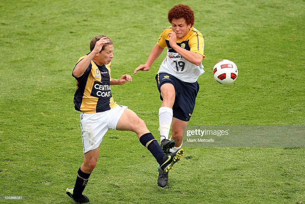 Mustafa Amini of the Young Socceroos and Patricio Perez of the Mariners compete for the ball during the friendly match between the Young Socceroos and the Central Coast Mariners at Bluetongue Stadium on September 23, 2010 in Gosford, Australia.
