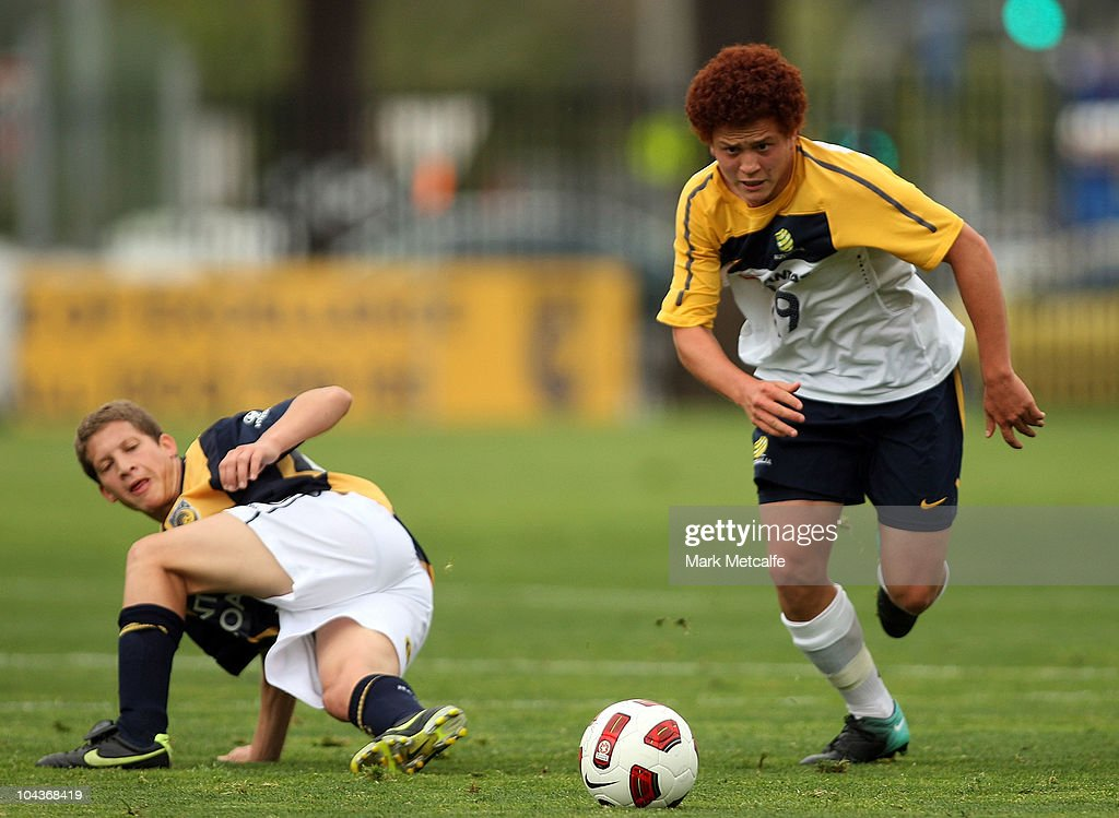 Mustafa Amini of the Young Socceroos runs with the ball during the friendly match between the Young Socceroos and the Central Coast Mariners at Bluetongue Stadium on September 23, 2010 in Gosford, Australia.