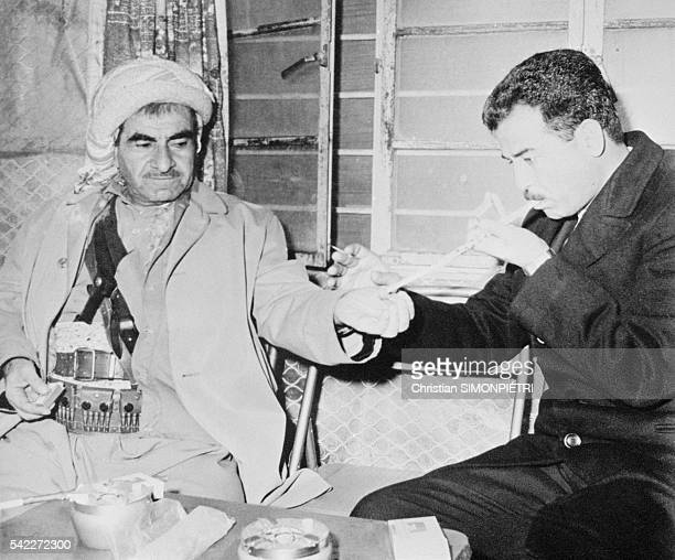 Mustafa Barzani founder of the Kurdish Democrat Party and Saddam Hussein during the signing of a Peace Treaty in Nao Peidam March 11 1970