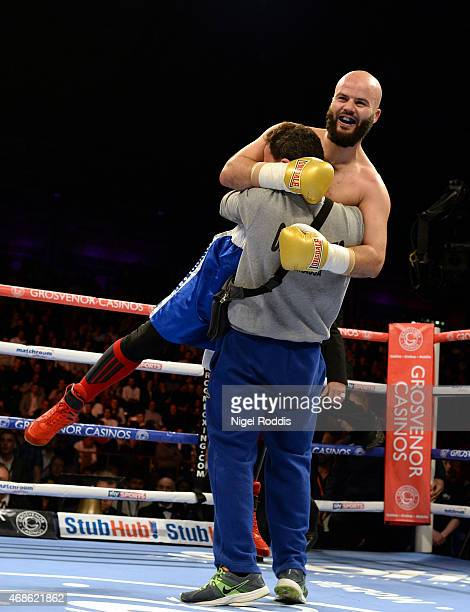 Mustafa Chadlioui celebrates after beating Travis Dickinson during their Light Heavyweight boxing contest at the Metro Arena on April 4 2015 in...
