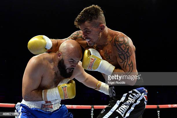 Mustafa Chadlioui in action with Travis Dickinson during their Light Heavyweight boxing contest at the Metro Arena on April 4 2015 in Newcastle upon...