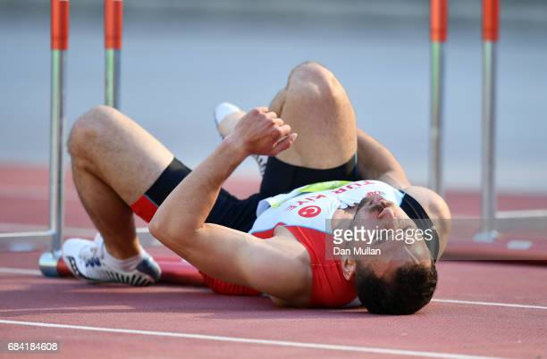 Mustafa Gunes of Turkey lies injured after falling in the Mens 110m Hurdles Final during day six of Baku 2017 4th Islamic Solidarity Games at the...