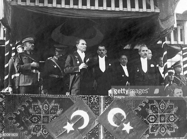 Mustafa Kemal Atatürk founder and President of the Turkish Republic watching a parade circa 1929
