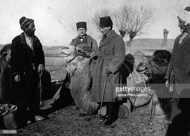 Mustafa Kemal Pasha Ataturk Turkish commander and later President with camel drivers during the TurkoGreek War