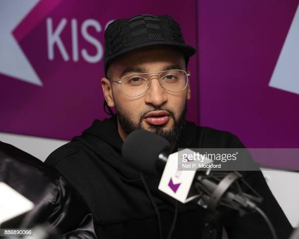 Mustafa Rahimtulla from X Factor winning group RakSu on with Ricky Melvin and Charlie at Kiss FM Studio's on December 6 2017 in London England