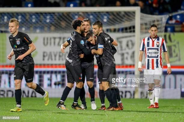 Mustafa Saymak of PEC Zwolle celebrates 22 with Younes Mohktar of PEC Zwolle Bram van Polen of PEC Zwolle during the Dutch Eredivisie match between...