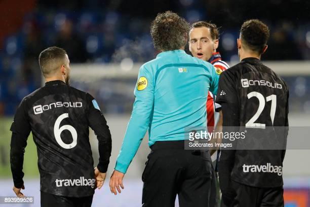 Mustafa Saymak of PEC Zwolle Referee Wiedemeijer Freek Heerkens of Willem II Younes Namli of PEC Zwolle during the Dutch Eredivisie match between...