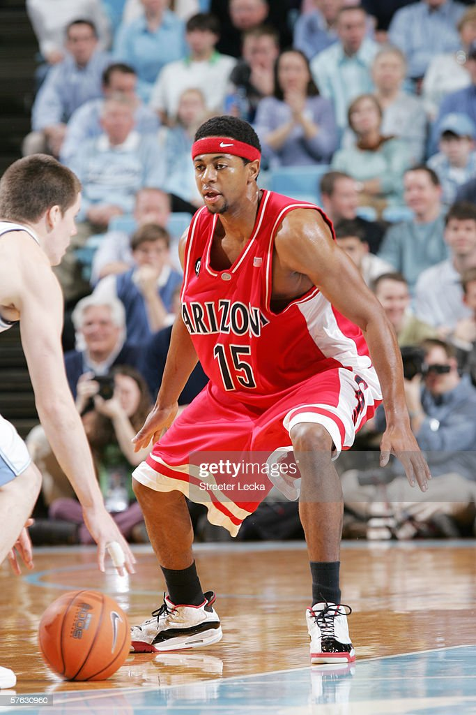 Mustafa Shakur #15 of the Arizona Wildcats defends against the University of North Carolina Tar Heels on January 28, 2006 at the Dean Smith Center in Chapel Hill, North Carolina. The Tar Heels won 86-69.
