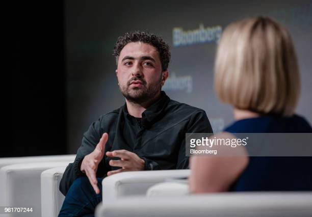 Mustafa Suleyman cofounder and head of artificial intelligence at DeepMind Technologies Ltd gestures while speaking during Bloomberg's Sooner Than...