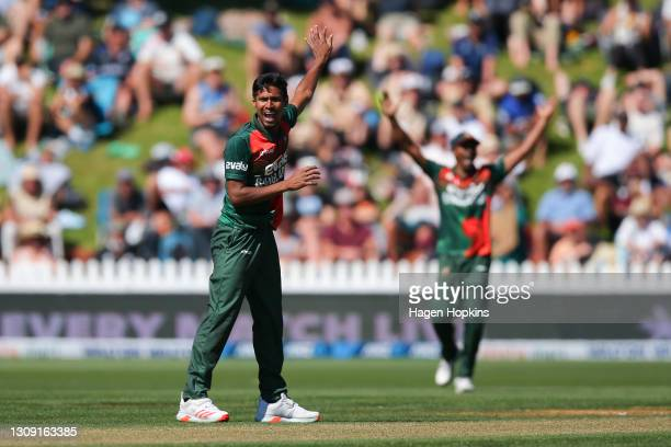Mustafizur Rahman of Bangladesh appeals unsuccessfully for the wicket of Devon Conway of New Zealand during game three of the One Day International...