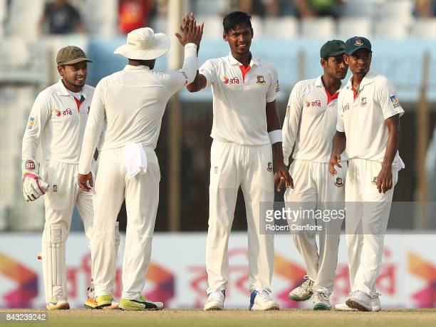 Mustafizur Rahman of Bangladesh celebrates after taking the wicket of Matthew Wade of Australia during day three of the Second Test match between...