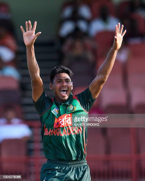 Mustafizur Rahman of Bangladesh celebrates the dismissal of Rovman Powell of West Indies during the 1st ODI match between West Indies and Bangladesh...
