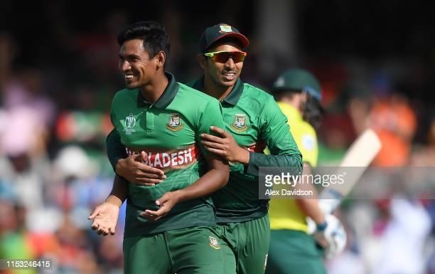 Mustafizur Rahman of Bangladesh celebrates the wicket of David Miller of South Africa with Soumya Sarkar of Bangladesh during the Group Stage match...