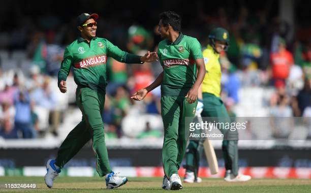 Mustafizur Rahman of Bangladesh celebrates the wicket of David Miller of South Africa with Soumya Sarkar of Bangladesh during the Group Stage match...