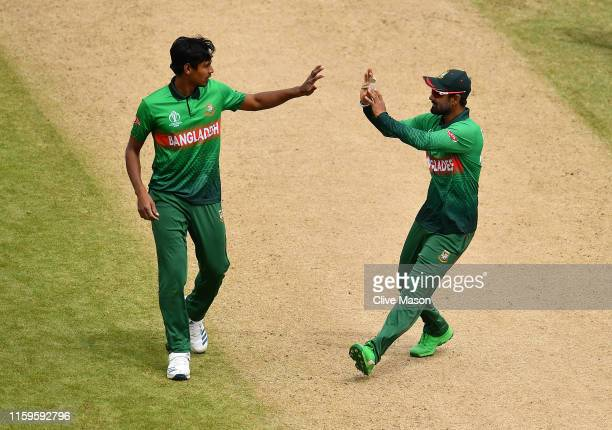 Mustafizur Rahman of Bangladesh celebrates the wicket of Hardik Pandya of India with Liton Das of Bangladesh during the Group Stage match of the ICC...