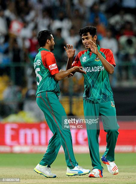 Mustafizur Rahman of Bangladesh celebrates the wicket of Steven Smith Captain of Australia during the ICC World Twenty20 India 2016 match between...