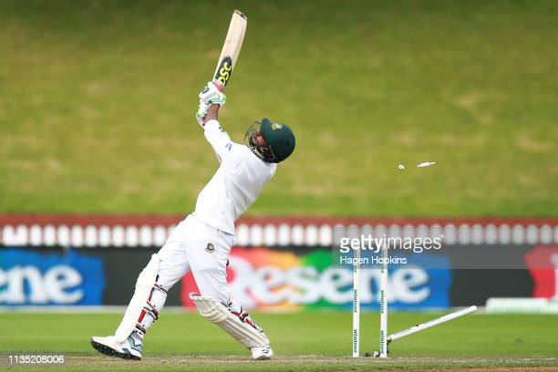 Mustafizur Rahman of Bangladesh is bowled out by Trent Boult of New Zealand during day five of the second test match in the series between New...