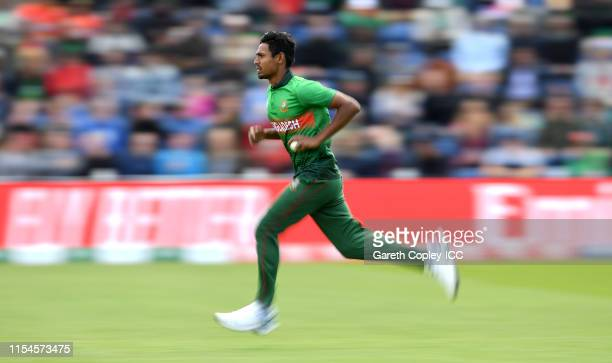Mustafizur Rahman of Bangladesh runs into bowl during the Group Stage match of the ICC Cricket World Cup 2019 between England and Bangladesh at...