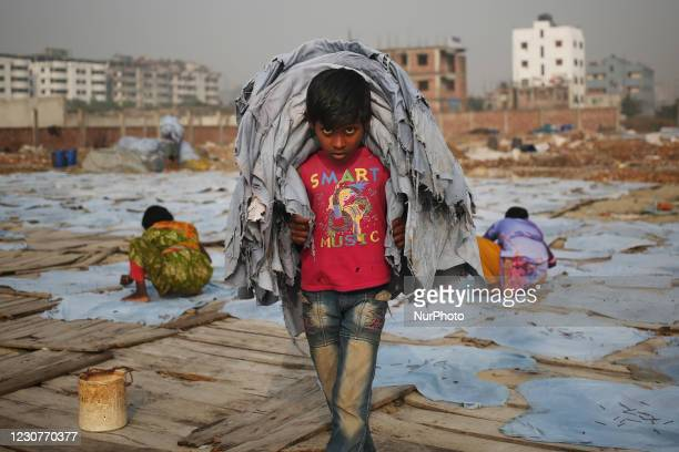 Mustakin, works at a Tanney to earn one dollar a day in a low-income area in Keraniganj, Dhaka, Bangladesh on Sunday, January 24, 2021. According to...