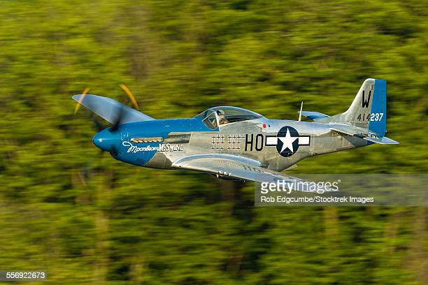 A P-51 Mustang flies along the Mississippi at Dubuque, Iowa.