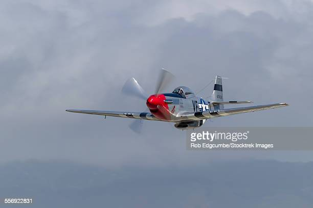 a p-51 mustang flies by at half moon bay, california. - p 51 mustang stock photos and pictures
