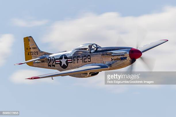 a p-51 mustang flies by at vacaville, california. - p 51 mustang stock photos and pictures