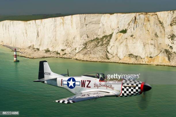 a mustang p-51 pilot flying his plane past beachy head, england. - beachy head stock photos and pictures