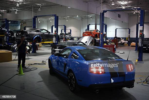 Mustang sports car backs out of a maintenance bay on the factory floor while receiving upgrades at the Shelby American Inc world headquarters in Las...