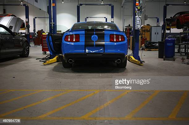 Mustang sports car sits parked in a maintenance bay on the factory floor while receiving upgrades at the Shelby American Inc world headquarters in...