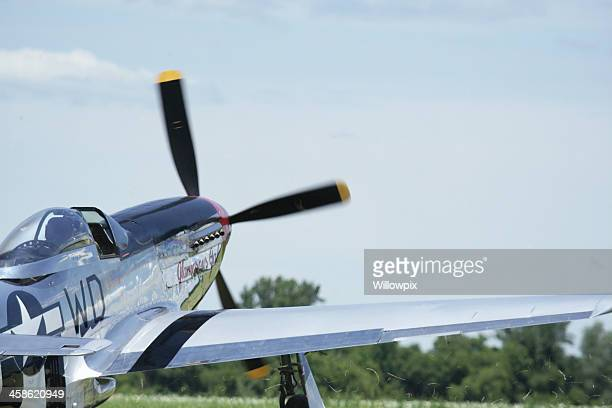 p-51d mustang wwii military fighter airplane kicking up swirling grass - p 51 mustang stock photos and pictures