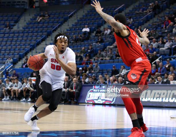 Mustangs forward Ben Moore drives to the basket during the first half of the American Athletic Conference championship game between Cincinnati...